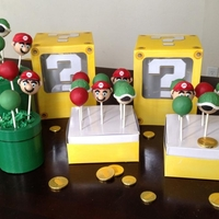 Mario Cakepops Mario and green turtle shells in custom made pipes and goild coin display boxes