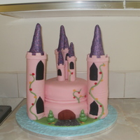 Princess Castle Cake cakes are 10 inch & 8 inch sponge cakes filled with vanilla butter cream and strawberry jam covered with fondant, towers are swiss...