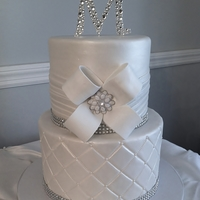 All White Wedding Cake With Bling And Custom Monogram Gumpaste Keepsake Topper All white wedding cake with bling and custom monogram gumpaste keepsake topper.
