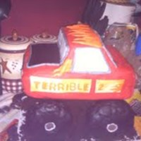 Monster Truck A birthday cake for a 2 year old. Its elevated on 4 in pillars and the wheels are RKT covered in fondant.