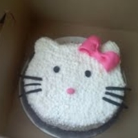 Hello Kitty Hello Kitty cake for 5th birthday. I made a 10 in round and shaped it down, using the excess to make the ears. Covered in buttercream with...