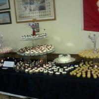 500 Cupcake Display For A Wounded Warrior Fundraising Event There Was Also An 8 Round Cake With The Wounded Warrior Emblem *500 Cupcake display for a Wounded Warrior fundraising event. There was also an 8' round cake with the Wounded Warrior emblem.