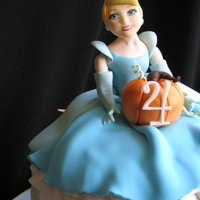 Cinderella Cake  Cake designed for a pretty little 4 yr old Cinderella loving gal! All decorations are done with 50/50 sugar paste and fondant and the...