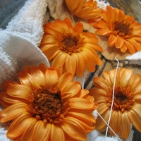 Gerbera Daisies   Gum paste Gerbera daisies for a wedding cake. Dusted in yellow, orange, brown and apricot powder color.