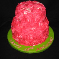 Rose Cake Two tiered pink/white swirled rose cake. Vanilla cake with raspberry filling and covered in vanilla buttercream.