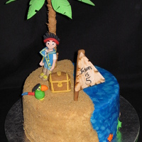 Jake And The Neverland Pirates Chocolate fudge cake, raspberry filling, marshmallow fondant. All decorations are gumpaste. I absolutely love how the palm tree turned out...