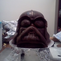 Darth Vader This took 5 cakes. I used rice krispy for the mouthpiece. I was short on time so this was also the first and only time I used bought...