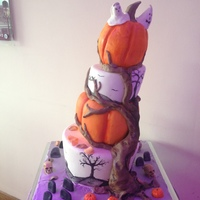 Halloween Wedding Cake This is a Halloween wedding cake that I did. His is hand painted around he 2nd and 4th tier.