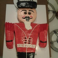 "Nutcracker Cake  I used a standard 9""x13"" and cut the angle of the body to get the arms and the brim of the hat. The head is an 8"" circle and..."