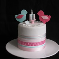 2 Little Birdies! 2 Little Babies! This is a cake for 2 little babies - 1 boy, 1 girl for their joint 1st birthday party! Layered with white chocolate ganache. 7 inches in...