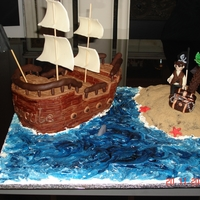 Ahoy Me-Heartys! Pirate ship cake, made using the 3d sturdy chocolate cake recipe from cc, filed with French Vanilla BC, and covered in ganache and fondant...