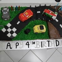"Cars 2 - Racing To The Finish Line! My son's 4th birthday cake in Cars 2 theme. 2x12"" square cakes (one vanilla and the other chocolate) with an 8"" white..."