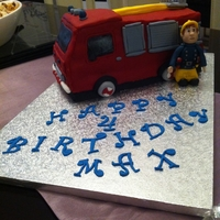 Fireman Sam & Jupiter 'Durable cake for 3D and weddings' cake with chocolate buttercream filling/frosting and covered in fondant. Fireman Sam made out...
