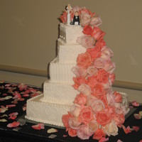 Coral Cascading Roses This was my first BIG buttercream wedding cake and the most i've used fresh flowers also. While I have to admit I prefer working with...