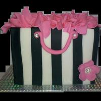 "Small Gift Bag Cake The cake pictured is only about 6"" in length. The entire cake is done in fondant. Stripes.. tissue... flower and handles."