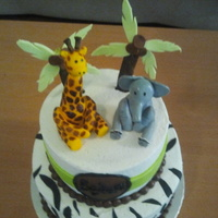 Jungle Animals Cake This was a first birthday cake. I think the original design might have come from here. The client brought me a picture of what she wanted...