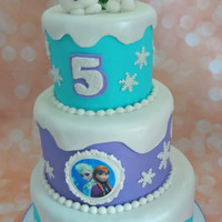 "Three Tier Frozen Cake Mini three tier Frozen Olaf cake. 8"", 6"", & 4"" cake. Elsa and Anna are an edible image"