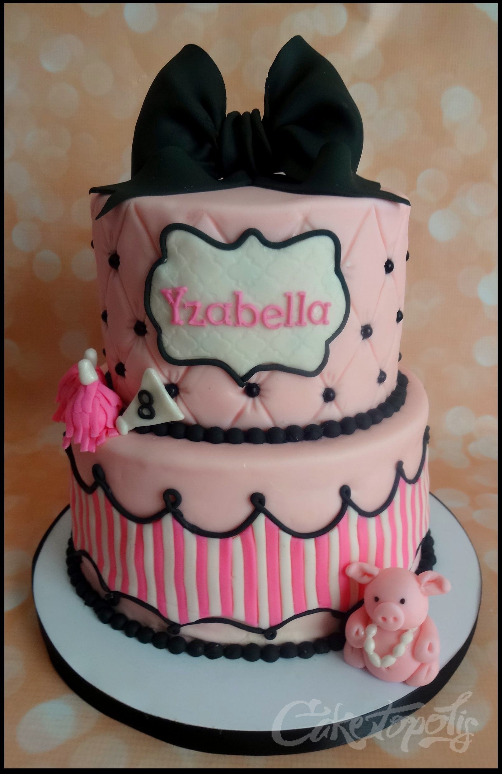 "Pink And Black Boutique Birthday Cake 8"" & 6"" boutique birthday cake with fondant pig and pom poms."