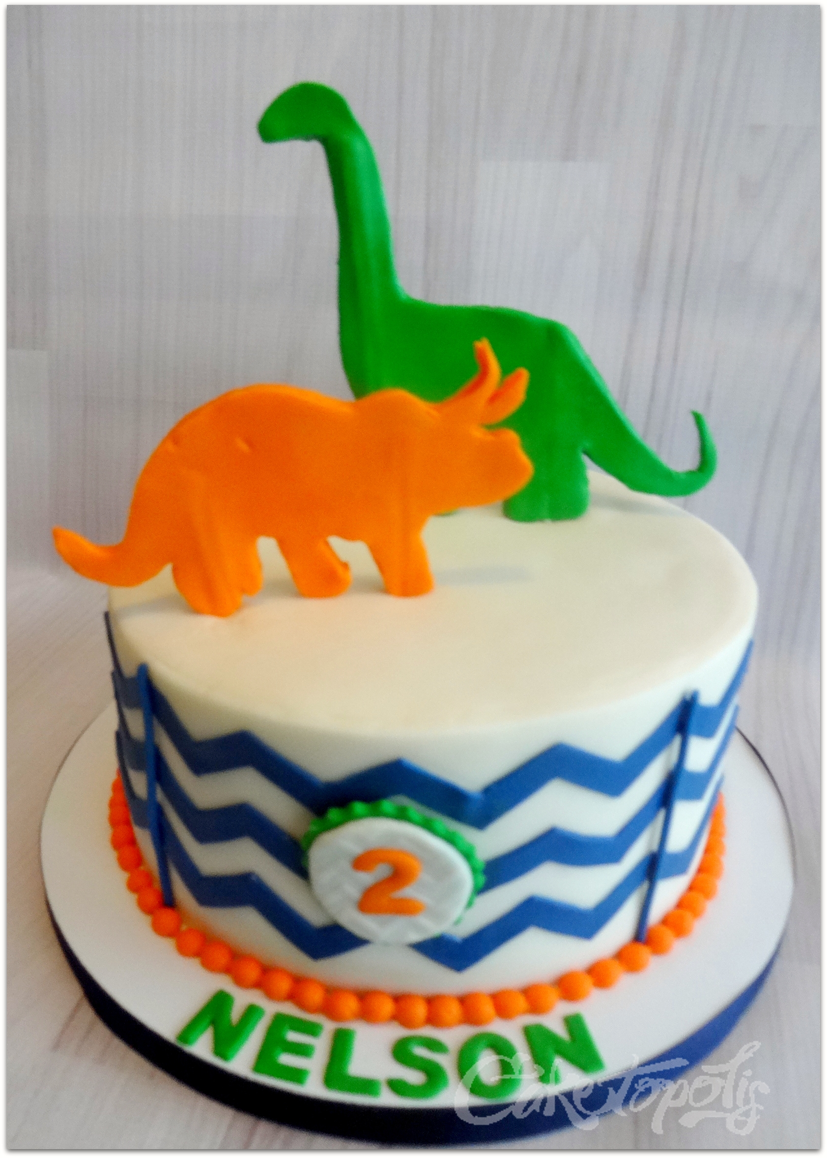 "Dinosaur Chevron Cake Dinosaur silhouette chevron birthday cake. 8"" cake using Marvelous Molds small chevron only."
