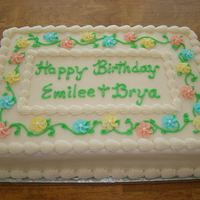 Happy Birthday Emilee & Brya 1/4 Sheet Vanilla Butternut Pound Cake with Raspberry Filing and Vanilla Buttercream Icing - decorated with flowers and vines.