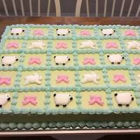 Baby Shower Sheet Cake 1/2 Sheet cake with vanilla buttercream icing and rolled fondant decorations. Sheep, bunnies, and bows.
