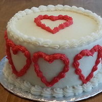 "Valentine's Day Hearts Cake Little, 6"" rounds of Vanilla Butternut Pound Cake with real Buttercream Icing decorated with piped Red Hearts."