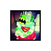 Spider Man, Batman, & Superman Cake This tilted superhero cake was for a client that gave us full creative freedom we decied to do the clients sons favorite super heros in one...