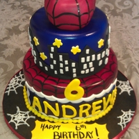 Spiderman City 2 Tier Spiderman City theme cake with 3d RKT Spidey Head , hand painted webbing