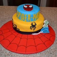 Spider-Man Cake  White cake with fondant - 1st try using fondant on a cake. My son loved it :) I borrowed the design from a picture online, whoever made the...