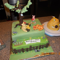 Classic Pooh 1St Birthday I made this cake for my son's first birthday I made the figures never done that before. My husband does not like fondant so I did the...