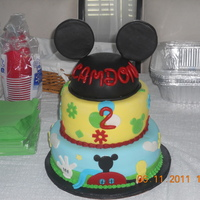 Mickey Mouse Clubhouse Cake. I made this cake for my sisters friends 2nd birthday. I got the idea from this site thanx to all for the idea.