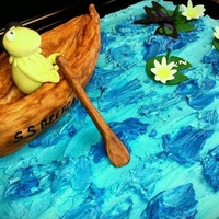 Kermit The Frog Rowing A Canoe   Kermit the frog rowing a rice treat canoe on top of a 1/2 sheet cake topped with lily pads and dragon fly