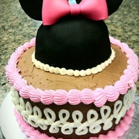 Minnie Mouse Ears And Bow Cake   Fondant bow with rice treat Minnie Mouse ears on top of buttercream cake