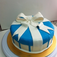 Gift Box Cake!   Vanilla cake, filled with Ganache and covered with fondant!