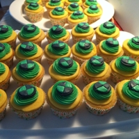 Ben 10 Themed Cupcakes!   Chocolate cupcakes with BC, fondant accents.