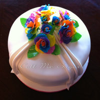 Rainbow Roses Anniversary Cake Customer wanted rainbow roses made to mimic the ones her husband had bought her. I made it a rainbow cake inside as well for fun. I haven&#...