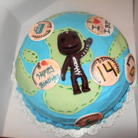 Little Big Planet And Sack Boy A buttercream cake with fondant and gumpaste accents. Sack boy was made with modeling chocolate and the badges were made with gumpaste and...