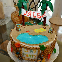 Luau Birthday Cake done for Customer for Luau themed Birthday. All accents done with Fondant and Gumpaste