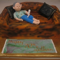 "Lillian A ""sofa"" cake with reclining sugarpaste figure."