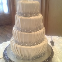 Pleated Elegance 4 tier pleated cake covered in fondant and sprayed with a pearl dust for a polished finished