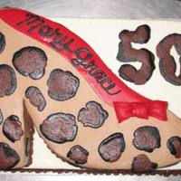 Surprise 50Th Cheetah Print Show Is A Carved Shape From A 9X13 Stacked On Another 9X13 The Print Is Buttercream While The Shoe Sole And B Surprise 50th. Cheetah print show is a carved shape from a 9x13 stacked on another 9x13. The print is buttercream while the shoe sole and...