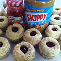 Peanut Butter And Jelly Cupcakes Peanut butter cupcake with peanut butter buttercream and strawberry jelly