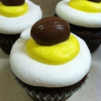 Cadbury Cream Egg Cupcakes Chocolate cake with a Cadbury Cream Egg baked inside - topped with buttercream icing and a Cadbury Cream Egg