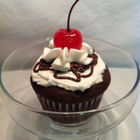 Hot Fudge Sundae Cupcake I posted directions on how I made this on my blog. http://thekitchendunce.blogspot.com/2012/02/hot-fudge-sundae-cupcake.html