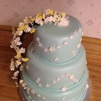 3 Tiered Covered In Fondant With Gumpaste Flowers 3 tiered covered in fondant with gumpaste flowers.
