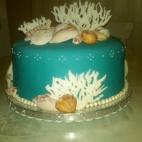 Beach Theame/ Sea Shells This was for a bridal shower. She wanted a beach theme with seashells. The shells are made of fondant except the star fish and coral are...