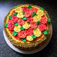 Fall Roses Cake This is a cake I made last Fall just for fun. It's a two-layer chocolate cake with vanilla buttercream icing. The Roses ontop are all...