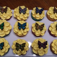 Butterfly Cupcakes Buttercream piped flowers, hand-painted fondant butterflies, yellow
