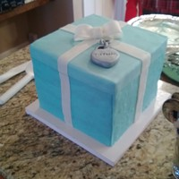 5 Layers Of Vanilla Cake With Vanilla Buttercream Covered In Tiffany Blue Tinted Fondant With Fondant Bow And Charm 5 layers of vanilla cake, with vanilla buttercream, covered in tiffany blue tinted fondant with fondant bow and charm