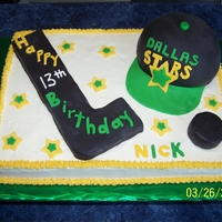 Dallas Stars Hockey team sheey cake with cap stick and puck